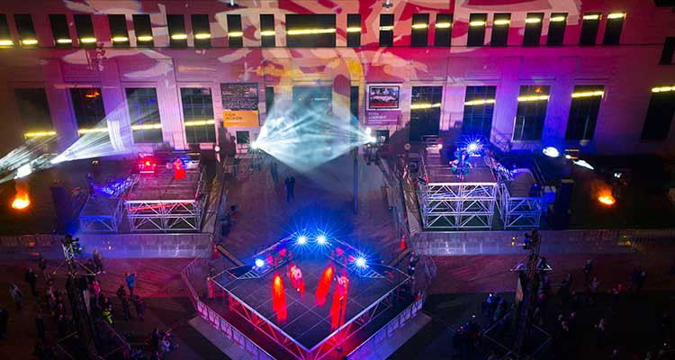 Three stages in Civic Square with stage lighting effects.